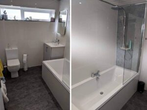 concrete and white bathroom wet wall boards