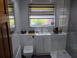concrete and white bathroom